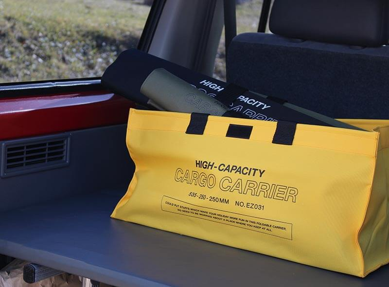 hightide cargo bag yellow in large size in a car trunk