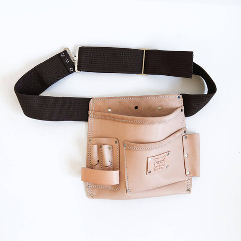 A 5 pocket quality natural leather tooolbag with dark brown waist belt