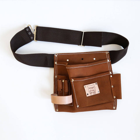 A 5 pocket quality brown suede leather tooolbag with dark brown waist belt