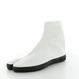 White canvas split toe shoe ankle high with black rubber sole by Moonstar