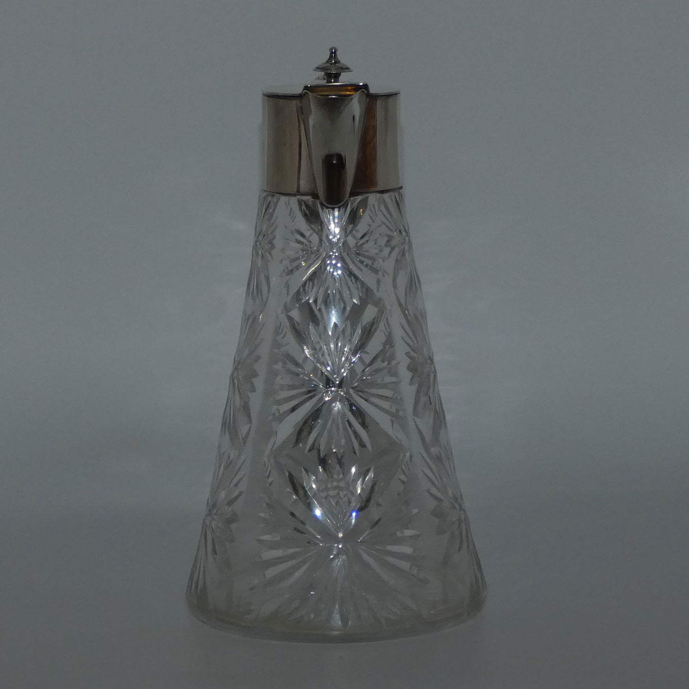 Art Deco shape wide base cut crystal claret jug with EPNS mounts