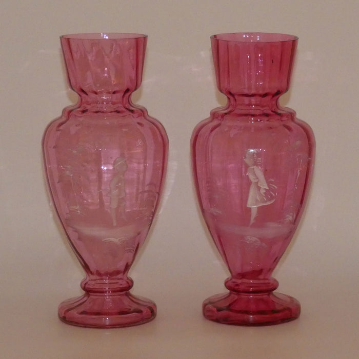 Cranberry Mary Gregory pair of vases depicting a boy with a walking cane and a girl on tip toes