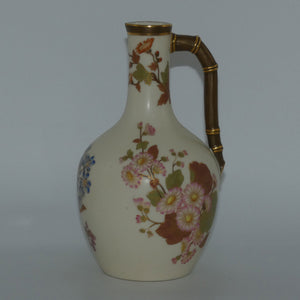 Royal Worcester Blush Ivory and gilt hand painted floral jug with bamboo style handle