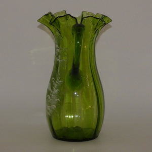 Green Mary Gregory crimped rim glass jug depicting a young girl sitting on bench