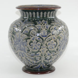 Doulton Lambeth George Tabor stoneware bulbous jardiniere with incised gargoyle faces and foliage decorations
