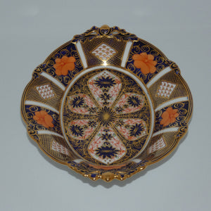 Royal Crown Derby Old Imari oval handled bowl with tiny quad feet