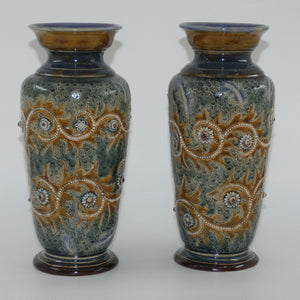 Doulton Lambeth George Tinworth stoneware pair of conical vases with applied baguette beads and foliage