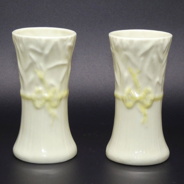 Belleek pair of Ribbon Spill vases (Brown base stamp)