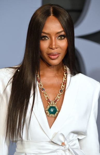 best hair cut for a heart shaped face, naomi campbell hair style, middle part hair styles, long one length hair cut