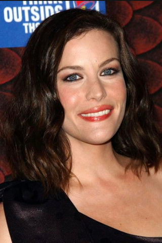 liv tyler hair styles, best cut and color for an oblong face shape, brunette, long bob, side part wavy hair