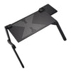 Image of black foldable laptop table in bed