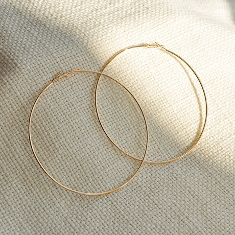 thin gold hoop earrings