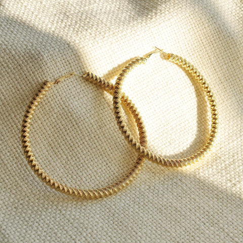 twist gold hoop earrings