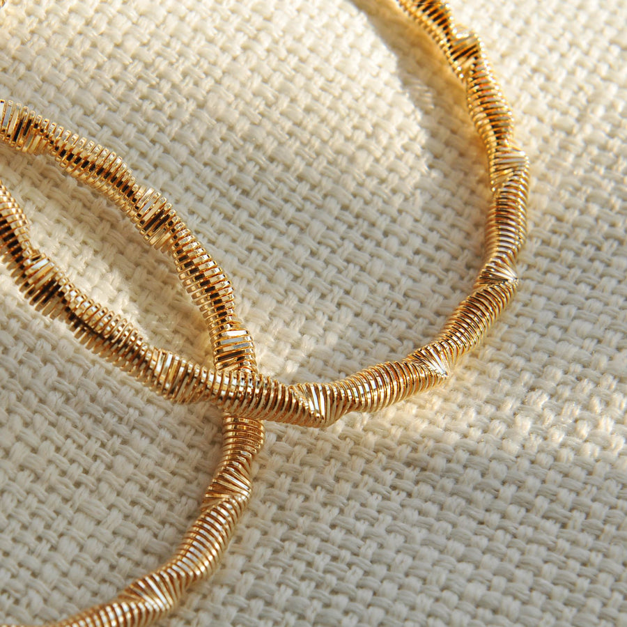 Riley gold effect twisted hoop earrings