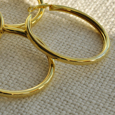 Close up of gold hoop earrings