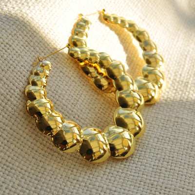 Gold statement earrings bubble