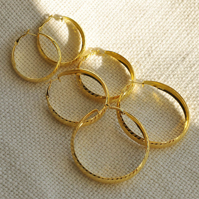 Set of gold hoop earrings