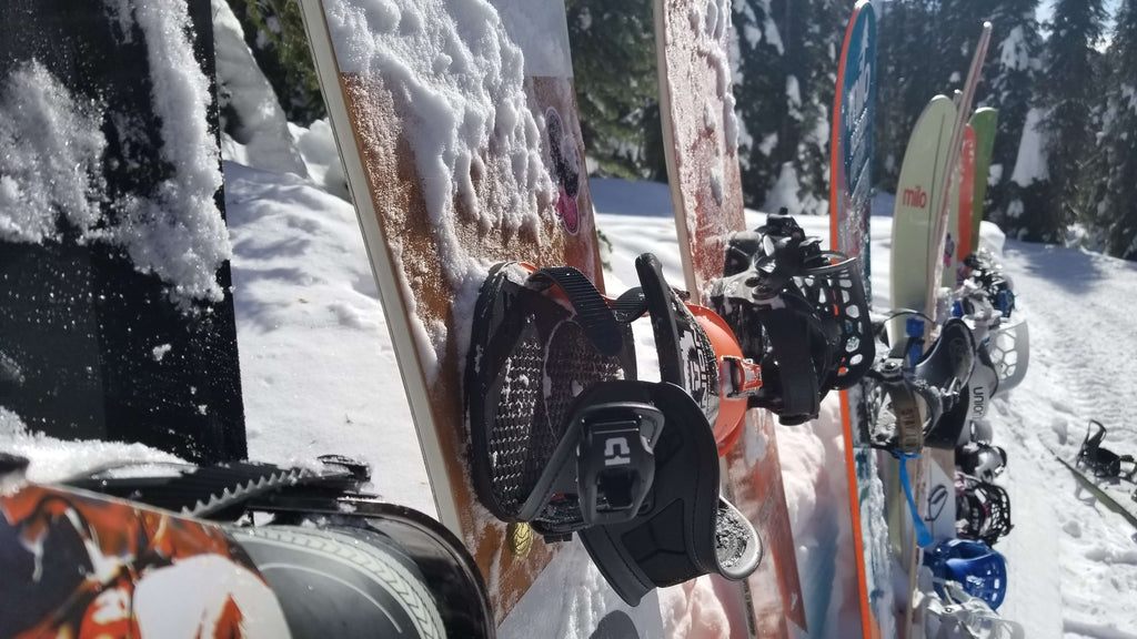 Union Snowboard Bindings Mounted on Spring Break Snowboards in a line on a trail at Baldface Lodge Nelson BC