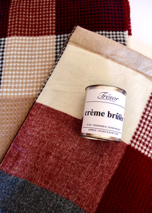 Creme Brûlée scented wood-wick hand poured candle and red/navy plaid and waffle knit blanket scarf.