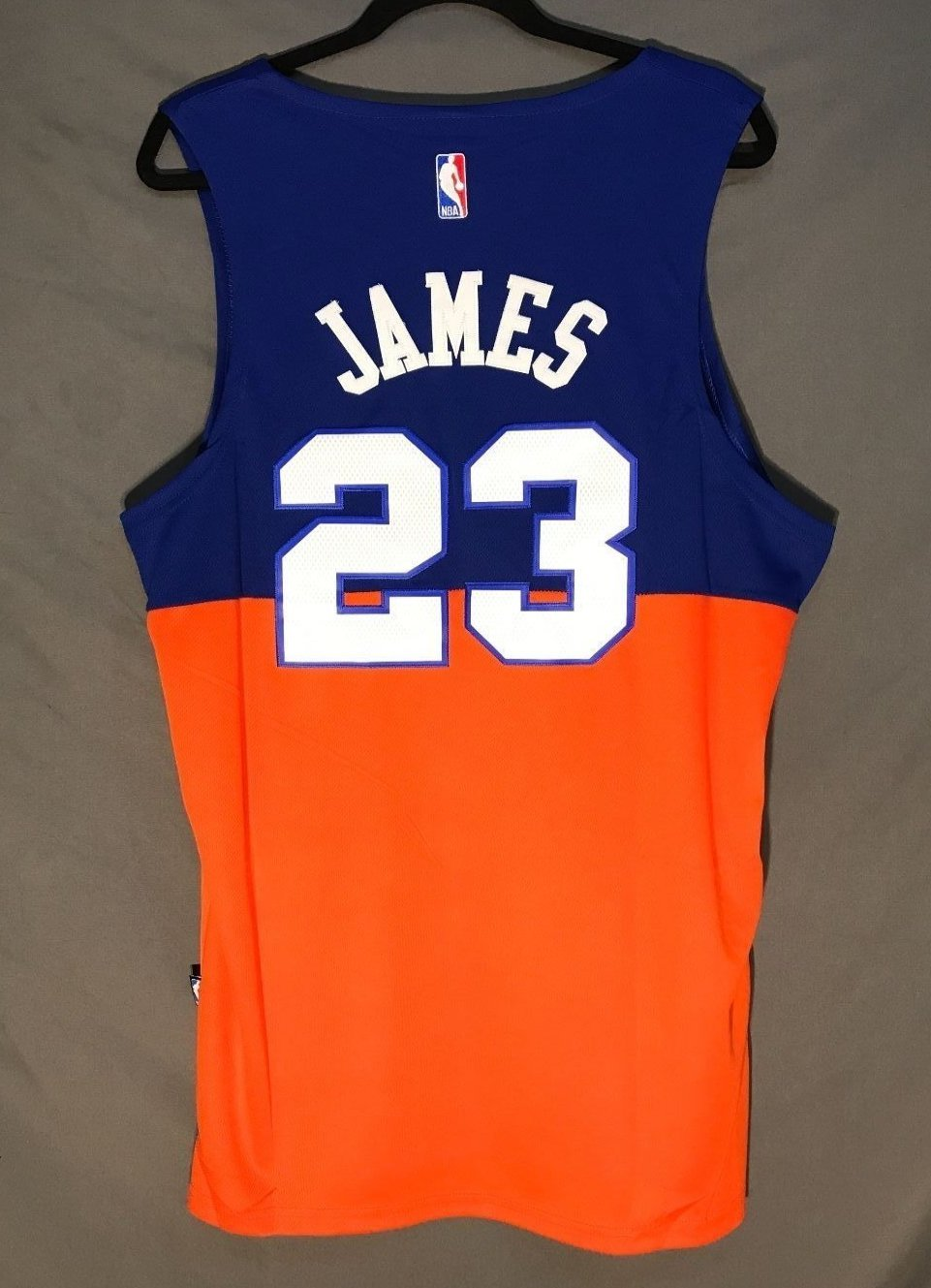 new arrival f7394 7e705 best price lebron james blue and orange cavs jersey f3352 46608