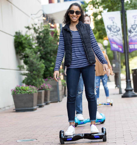 girl riding hoverboard