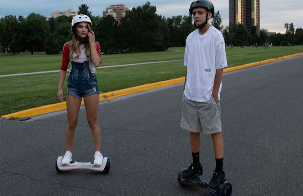 two kids on hoverboards