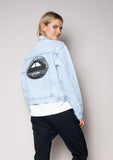 light denim jacket with sequin lips on the back we are the others