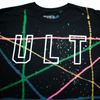 "Black tee on a white background. Tee features multi-color splatter type paint across the full tee shirt and a white outline ""ULT"" on the chest. Paint platters are in green, blue, yellow, and pink."
