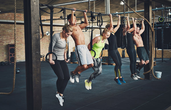 Group of Athletes Performing HIIT Workout