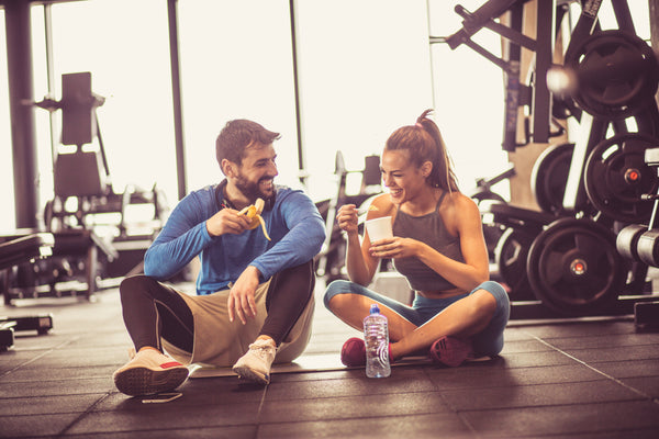 Couple Having Post Workout Snacks at Gym