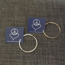 Load image into Gallery viewer, Earthyluxe by April Martin Earrings Hammered Hoops 14k Gold and Sterling Silver at Simply Skin Esthetics in Santa Cruz, CA
