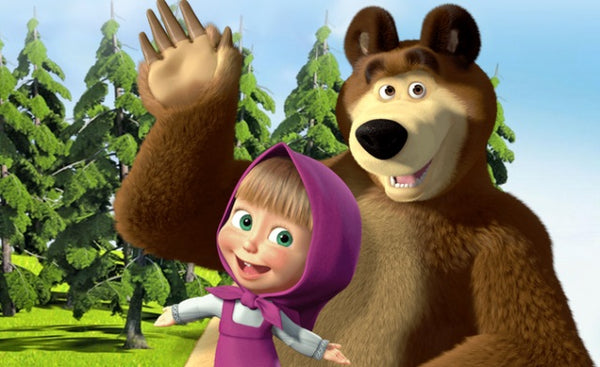 """Bear"" and ""Masha"" from ""Masha and the Bear"" stand in the background of the forest"