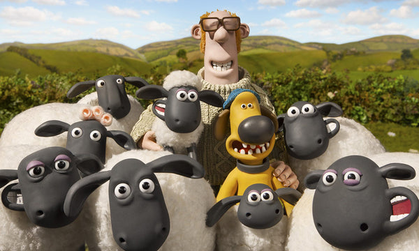 "Sheep, farmer and dog from ""Shaun the Sheep"" cartoon against the background of the hills"