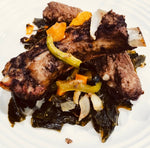 Braised Jerk Pork Ribs over a bed of Sautéed Kale