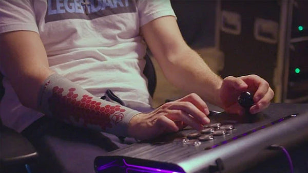 Alex Myers gaming with an eSmartr gaming arm sleeve on his arm.