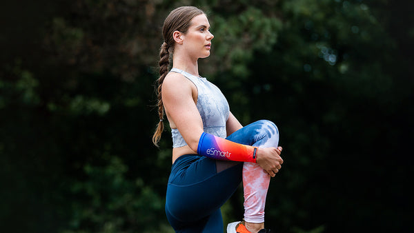 A woman stretches her legs to help over come anxiety before a sports competition.