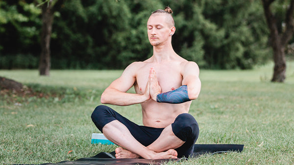 Man meditates to deal with stress in sport before a big game.