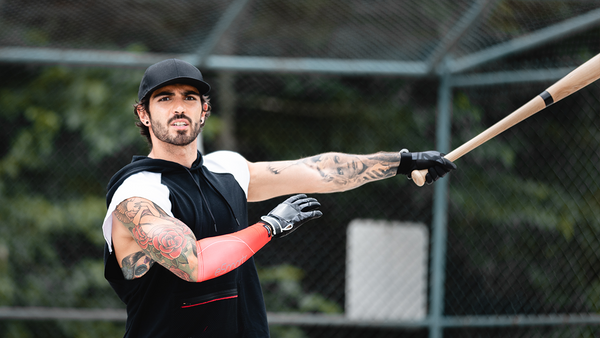 A baseball player reacts to his swing wearing an eSmartr sleeve.