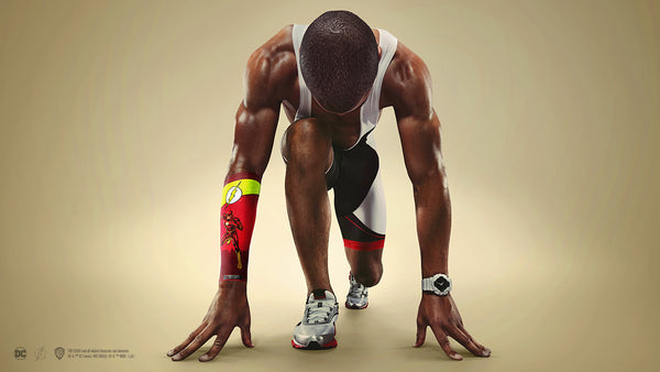 An athlete prepares to begin racing, with a Flash sleeve on his arm.