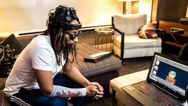 Lil Jon sees the results of his brain scan, before and after wearing smart compression technology.