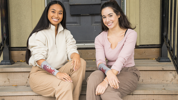 Two friends wear eSmartr sleeves to reduce stress and anxiety together.