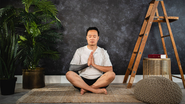 A man meditates to try and de-stress after a long way.
