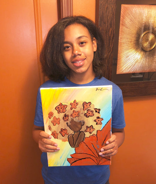 "Illustrator Sydney holding ""Fall in Love with Yourself"" painting."