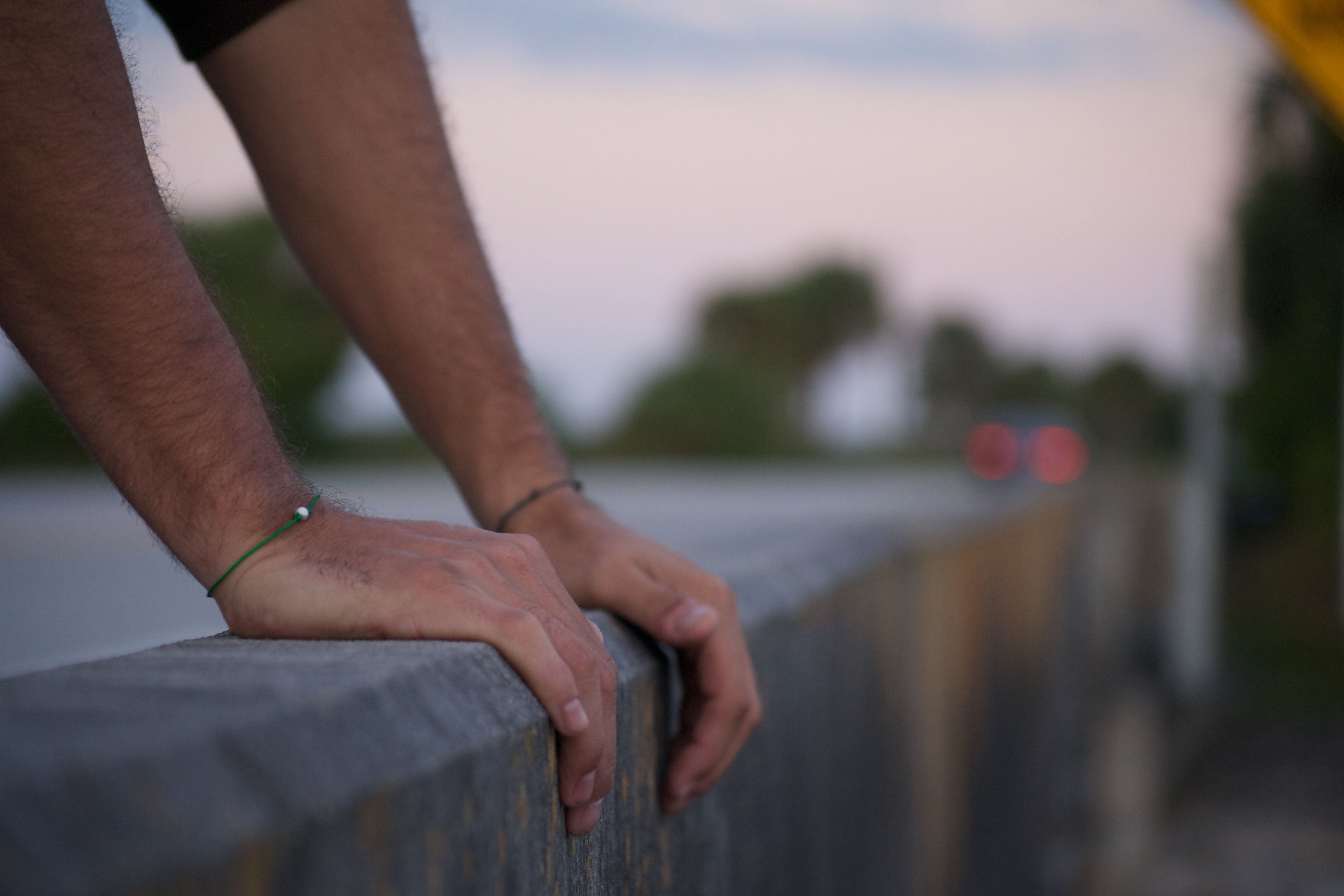 Modeled Love Hope Friendship Bracelet with, blurred, scenic background of a road