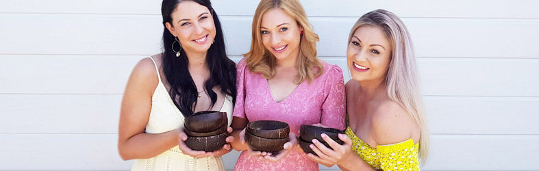 Girls with coconut bowls