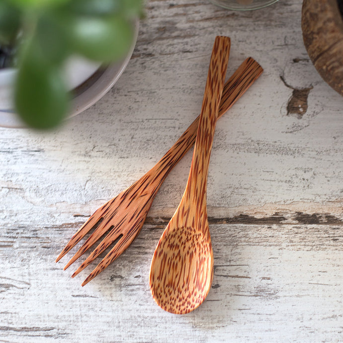 Coconut wood spoon and fork on table