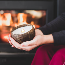 Load image into Gallery viewer, Enjoying a coconut candle in front of a fireplace