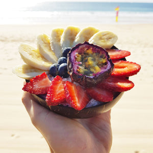 Acai at the beach in a coconut bowl