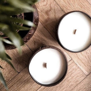 Coconut candles sitting on a table