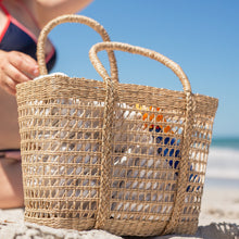 Load image into Gallery viewer, Seagrass bag at the beach.